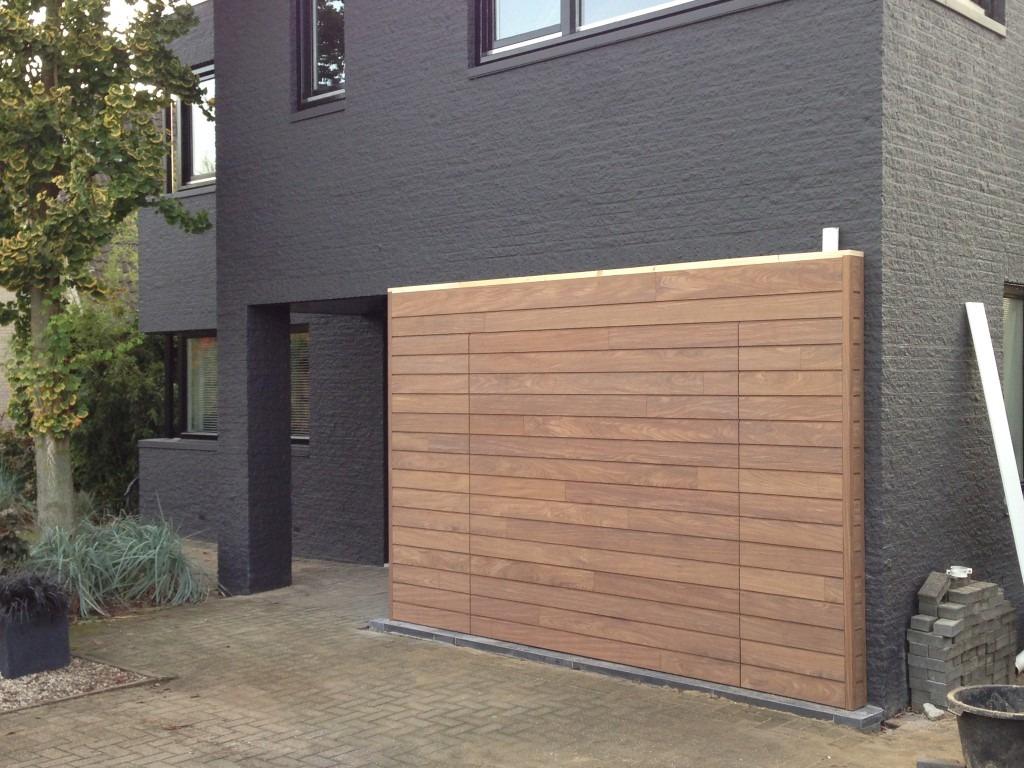Elektrisch houten sectionaaldeur beuningen different doors garagedeuren - Bekleed beton ...